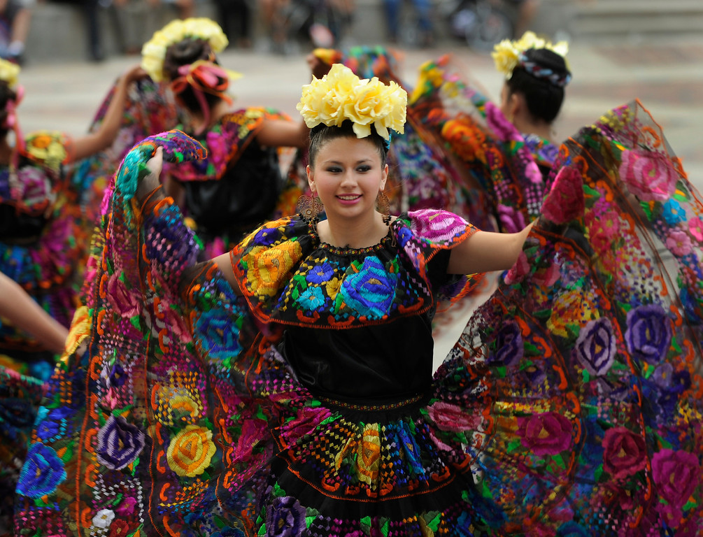 . Members of the Lisa Trujillo Dance Academy performed Thursday night. Denver celebrated Mexico Night in Civic Center Park Thursday night, July 18, 2013. The event was part of the Biennial of the Americas which is billed as an international festival of ideas, art, and culture. Photo By Karl Gehring/The Denver Post