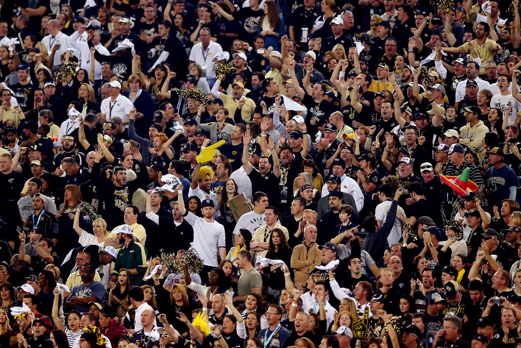 . Fans react after the UCF Knights defeated the Baylor Bears 52-42 in the Tostitos Fiesta Bowl at University of Phoenix Stadium on January 1, 2014 in Glendale, Arizona.  (Photo by Ronald Martinez/Getty Images)