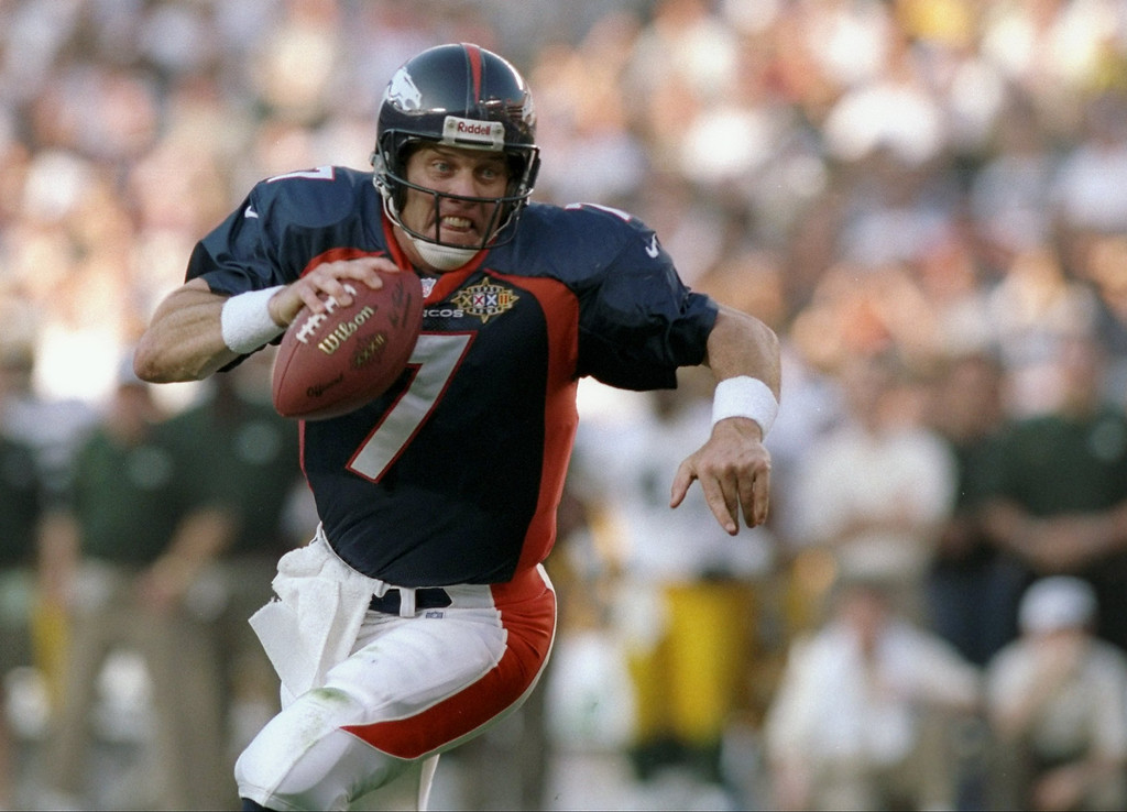 . Quarterback John Elway #7 of the Denver Broncos scrambles with the football against the Green Bay Packers during Super Bowl  XXXII at Qualcomm Stadium in San Diego, California.  The Denver Broncos defeated the Green Bay Packers 31-24. (Andy Lyons/Allsport)