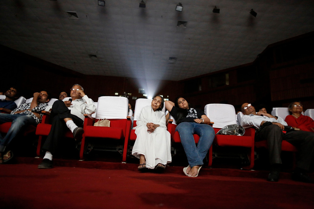 ". An audience watches a Hindi movie being screened during a festival celebrating 100 years of Indian cinema in New Delhi April 30, 2013. Indian cinema marks 100 years since Dhundiraj Govind Phalke\'s black-and-white silent film ""Raja Harishchandra\"" (King Harishchandra) held audiences spellbound at its first public screening on May 3, 1913, in Mumbai. Indian cinema, with its subset of Bollywood for Hindi-language films, is now a billion-dollar industry that makes more than a thousand films a year in several languages. It is worth 112.4 billion rupees (over $2 billion) and leads the world in terms of films produced and tickets sold. Picture taken April 30, 2013. REUTERS/Anindito Mukherjee"