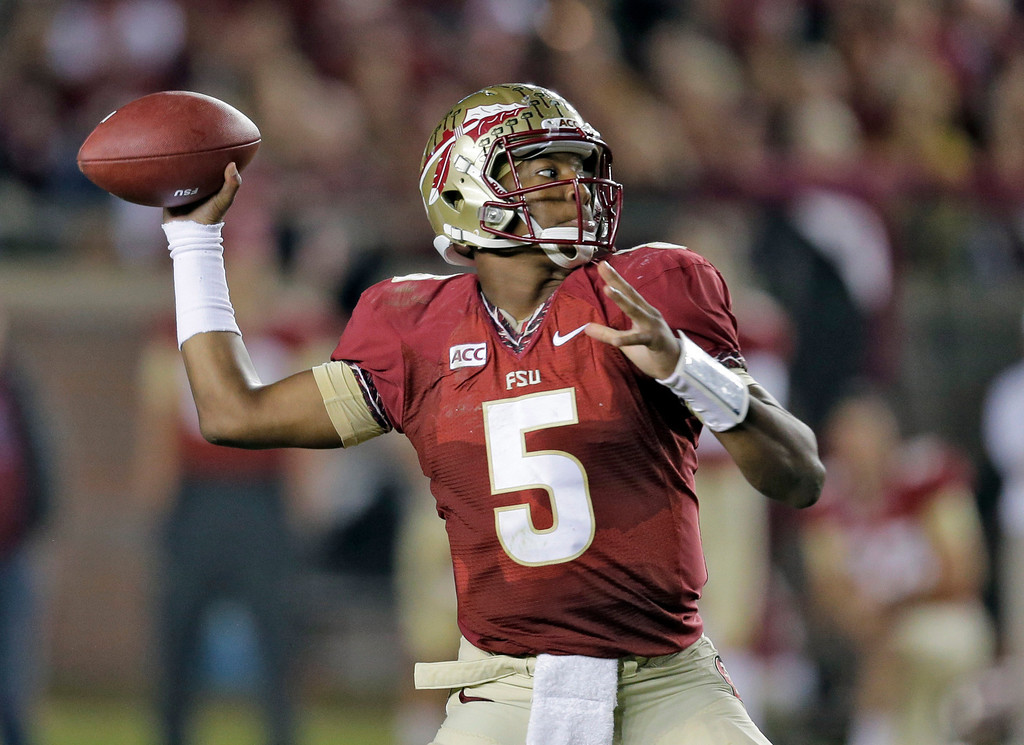 . In this Nov. 2, 2013 file photo, Florida State quarterback Jameis Winston throws a pass during the third quarter of an NCAA college football game against Miami, in Tallahassee, Fla. (AP Photo/Chris O\'Meara, File)
