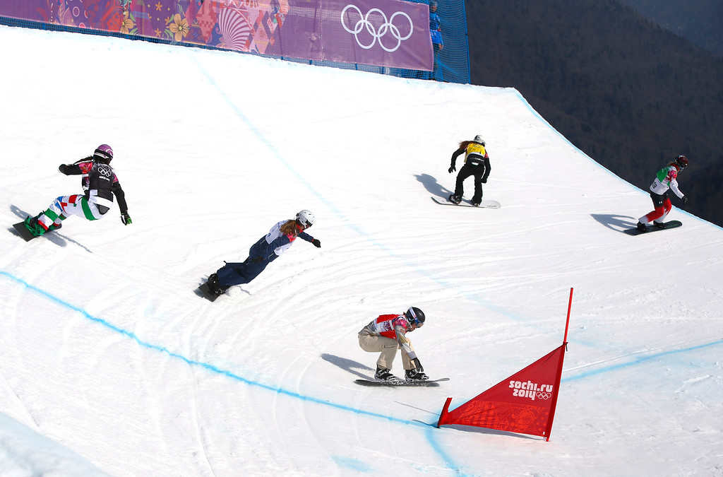 . Lindsey Jacobellis of the United States recovers from a crash in the women\'s snowboard cross semifinal at the Rosa Khutor Extreme Park, at the 2014 Winter Olympics, Sunday, Feb. 16, 2014, in Krasnaya Polyana, Russia. The other riders are, from left, Italy\'s Michela Moioli,  Britain\'s Zoe Gillings, Bulgaria\'s Alexandra Jekova, and at right the semifinal winner Canada\'s Dominique Maltais.  (AP Photo/Sergei Grits)