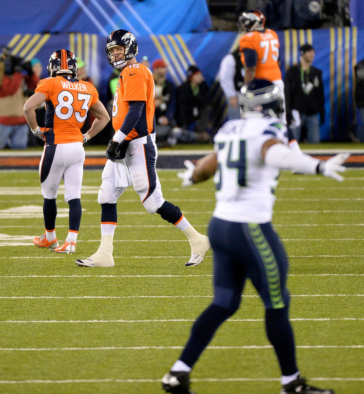 . Denver Broncos quarterback Peyton Manning (18) walks off after Seattle Seahawks outside linebacker Malcolm Smith (53) intercepted the pass for a pick 6 during the second quarter. The Denver Broncos vs the Seattle Seahawks in Super Bowl XLVIII at MetLife Stadium in East Rutherford, New Jersey Sunday, February 2, 2014. (Photo by AAron Ontiveroz/The Denver Post)