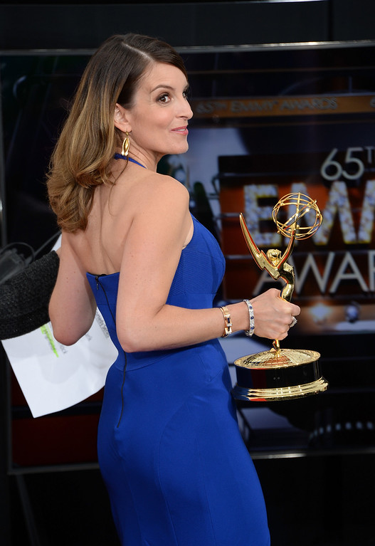 ". Co-Writer Tina Fey, winner of Best Writing for a Comedy Series Award for ""30 Rock\""  poses in the press room during the 65th Annual Primetime Emmy Awards held at Nokia Theatre L.A. Live on September 22, 2013 in Los Angeles, California.  (Photo by Jason Merritt/Getty Images)"