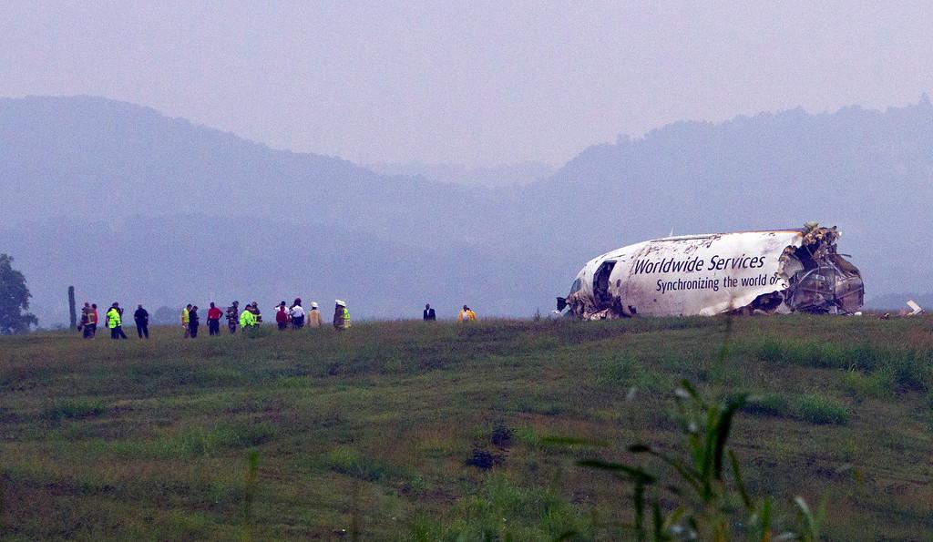 . A UPS cargo plane lies on a hill at Birmingham-Shuttlesworth International Airport after crashing on approach, Wednesday, Aug. 14,  2013, in Birmingham, Ala.  (AP Photo/Butch Dill)
