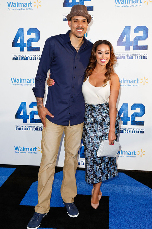 . Professional basketball player Matt Barnes (L) and television personality Gloria Govan attend the premiere of Warner Bros. Pictures\' And Legendary Pictures\' \'42\' at TCL Chinese Theatre on April 9, 2013 in Hollywood, California.  (Photo by Imeh Akpanudosen/Getty Images)