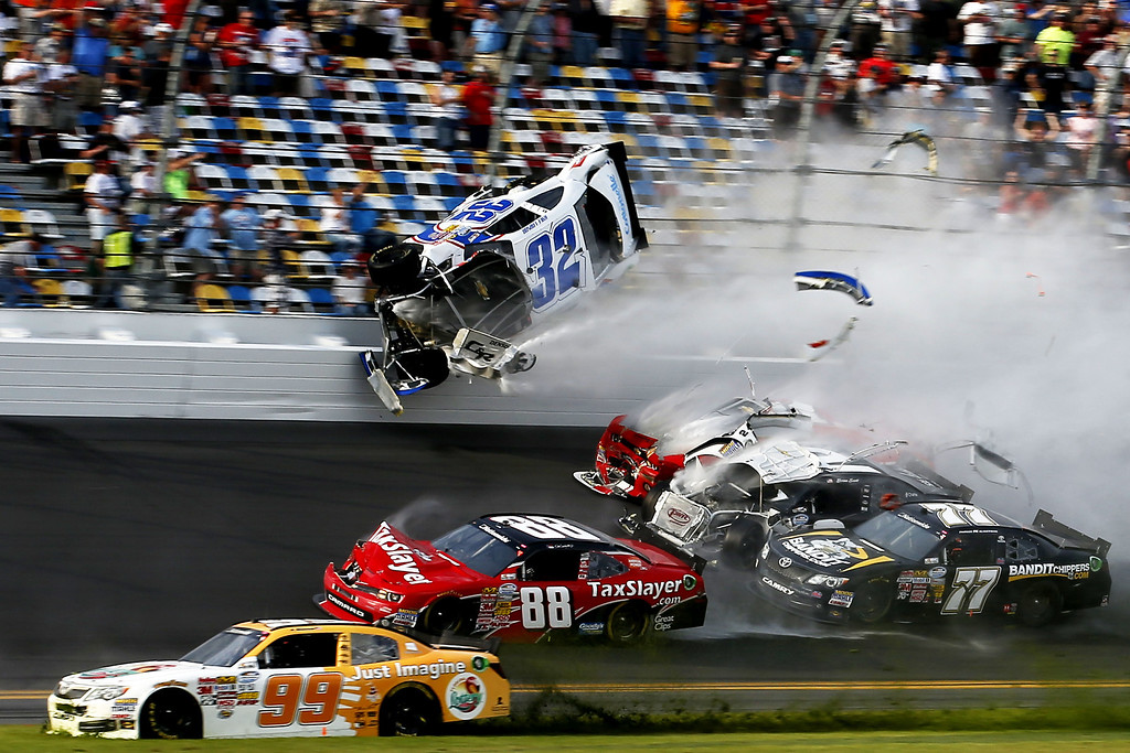 . DAYTONA BEACH, FL - FEBRUARY 23:  Brad Keselowski, driver of the #22 Discount Tire Dodge, and Kyle Larson, driver of the #32 Clorox Chevrolet, are involved in an incident at the finish of the NASCAR Nationwide Series DRIVE4COPD 300 at Daytona International Speedway on February 23, 2013 in Daytona Beach, Florida.  (Photo by Chris Graythen/Getty Images)