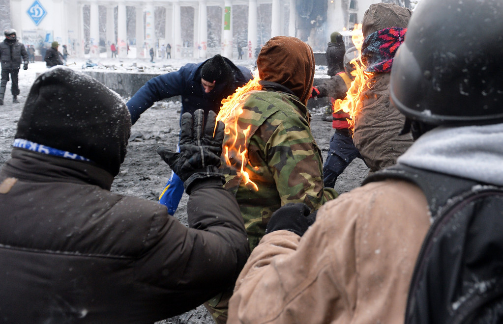 . The jacket of a protester burns during clashes in the center of Kiev on January 22, 2014. Ukrainian police on Wednesday stormed protesters\' barricades in Kiev as violent clashes erupted and activists said that one person had been shot dead by the security forces. Total of two activists shot dead during clashing. The move by police increased tensions to a new peak after two months of protests over President Viktor Yanukovych\'s failure to sign a deal for closer ties with the EU. AFP PHOTO/ SERGEI  SUPINSKY/AFP/Getty Images