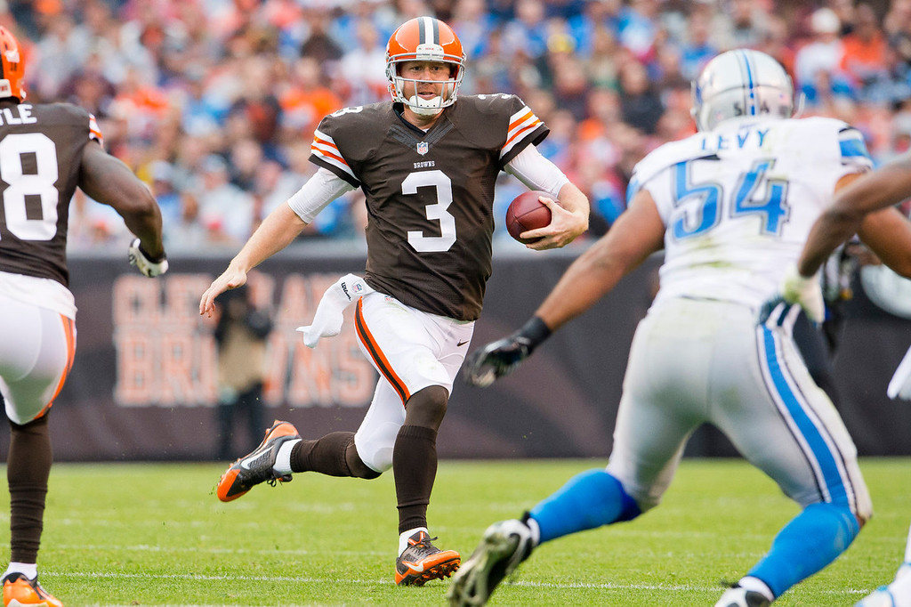 . Quarterback Brandon Weeden #3 of the Cleveland Browns scrambles for a gain during the first half against the Detroit Lions at FirstEnergy Stadium on October 13, 2013 in Cleveland, Ohio. (Photo by Jason Miller/Getty Images)