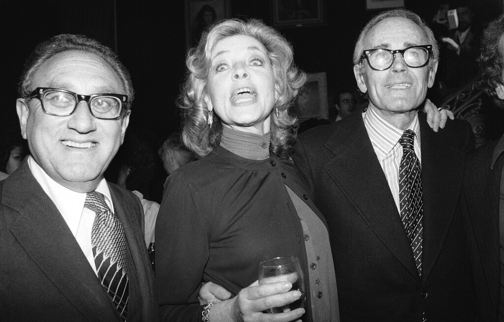". FILE - This June 8, 1979 file photo shows actress Lauren Bacall, center,  with Henry Kissinger, left, and actor Henry Fonda at a party to launch her autobiography,""By Myself\"" at the Palace Theater in New York. Bacall, the sultry-voiced actress and Humphrey Bogart�s partner off and on the screen, died Tuesday, Aug. 12, 2014 in New York. She was 89. (AP Photo/Ron Frehm, FIle)"