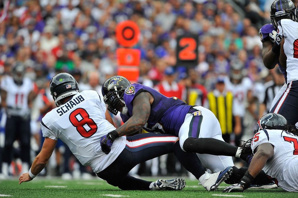 . Outside linebacker Terrell Suggs #55 of the Baltimore Ravens sacks quarterback Matt Schaub #8 of the Houston Texans at M&T Bank Stadium on September 22, 2013 in Baltimore, Maryland.  (Photo by Larry French/Getty Images)