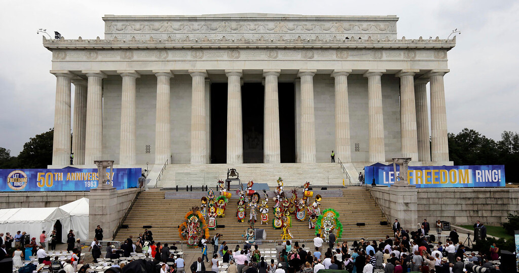 """. The group Junkaroo performs at the Let Freedom Ring ceremony at the Lincoln Memorial in Washington, Wednesday, Aug. 28, 2013, to commemorate the 50th anniversary of the 1963 March on Washington for Jobs and Freedom. It was 50 years ago today when Martin Luther King Jr. delivered his \""""I Have a Dream\"""" speech from the steps of the memorial.   (AP Photo/Carolyn Kaster)"""