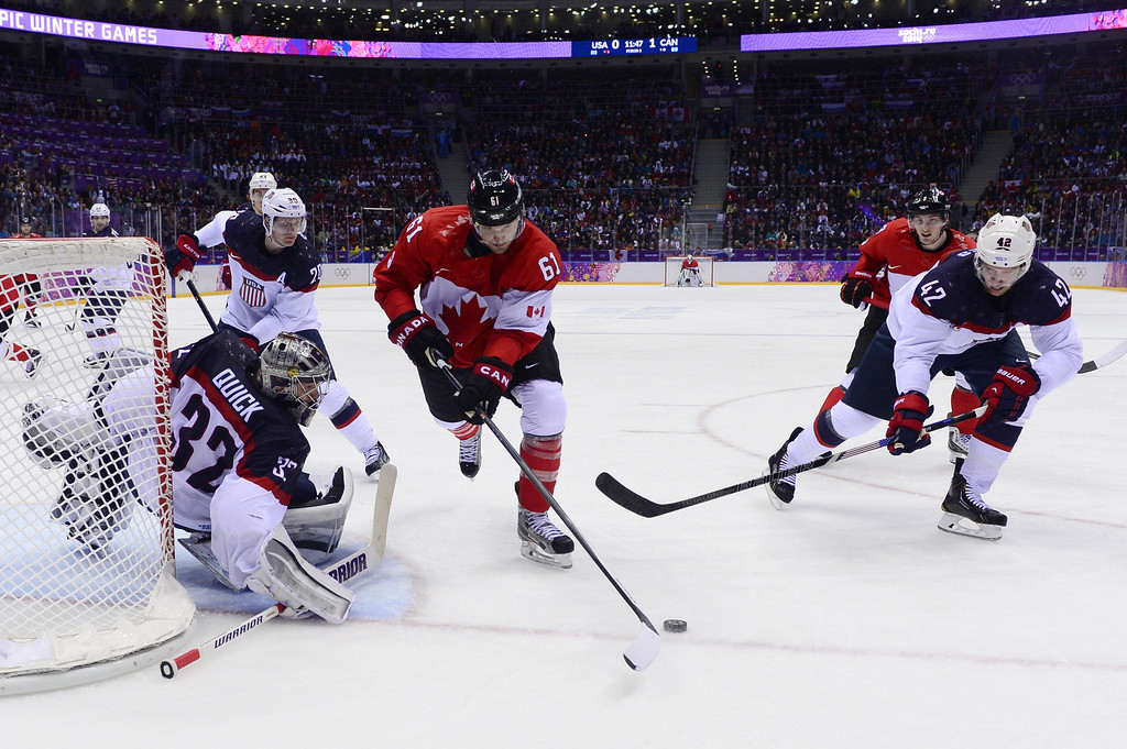 . Canada\'s Rick Nash (C) tries to score against US goalkeeper Jonathan Quick and US David Backes (R) during the Men\'s Ice Hockey Semifinals USA vs Canada at the Bolshoy Ice Dome during the Sochi Winter Olympics on February 21, 2014. JOHN MACDOUGALL/AFP/Getty Images