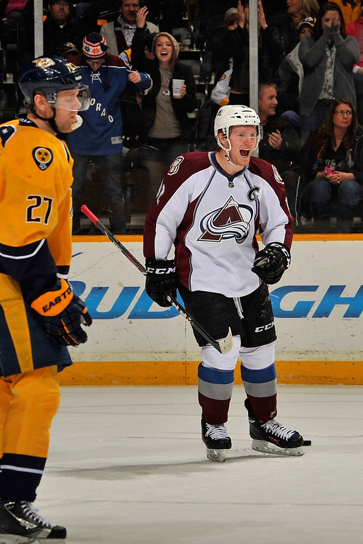 . NASHVILLE, TN - JANUARY 18: Gabriel Landeskog #92 of the Colorado Avalanche celebrates after a goal against the Nashville Predators at Bridgestone Arena on January 18, 2014 in Nashville, Tennessee.  (Photo by Frederick Breedon/Getty Images)