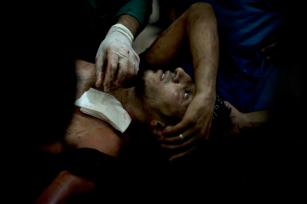 . A rebel fighter is brought to the Dar al-Shifa hospital in the northern city of Aleppo to be treated for his wounds on October 1, 2012, as fighting in Syria\'s second largest city between rebel forces and government troops continues. (ZAC BAILLIE/AFP/GettyImages)