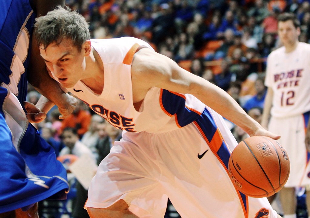 . Boise State\'s Anthony Drmic draws a foul on Air Force\'s Justin Hammonds, left, as he drives during the second half of their NCAA college basketball game, Wednesday, Feb. 20, 2013, in Boise, Idaho. Boise State won 77-65. (AP Photo/The Idaho Statesman, Joe Jaszewski)  LOCAL TV OUT