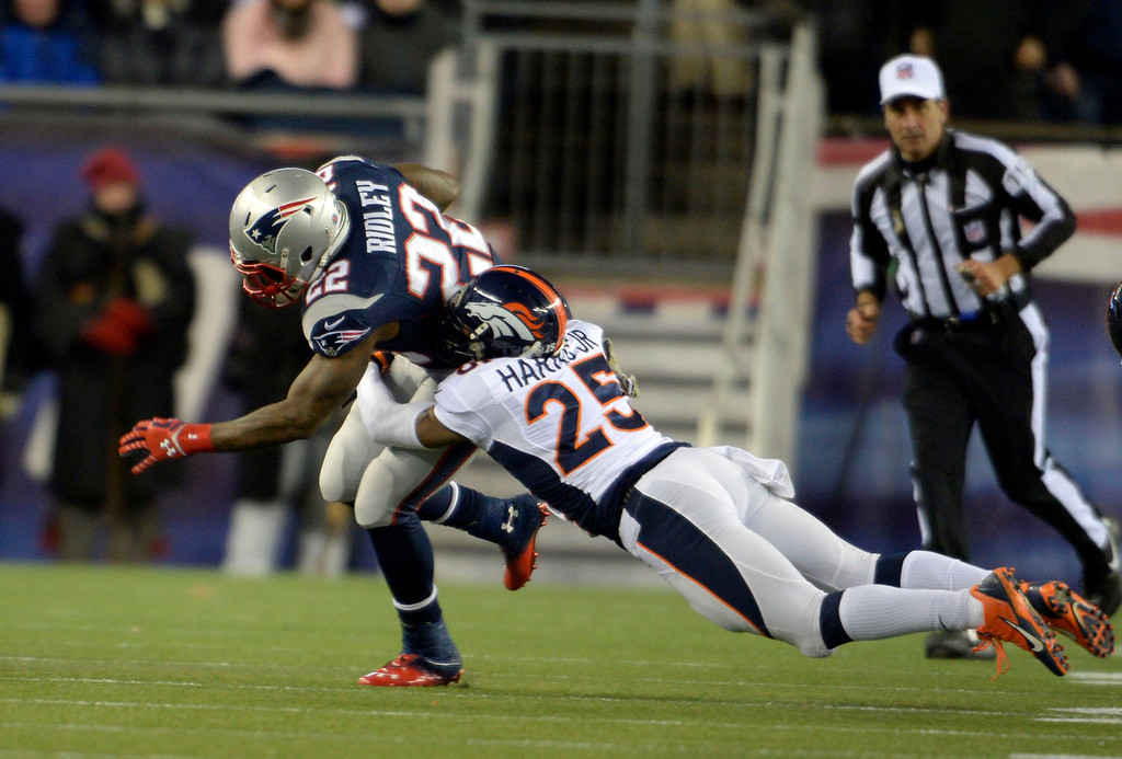 . Denver Broncos cornerback Chris Harris (25) comes in for a tackle on New England Patriots running back Stevan Ridley (22) during the first quarter November 24, 2013 at Gillette Stadium. (Photo by Joe Amon/The Denver Post)