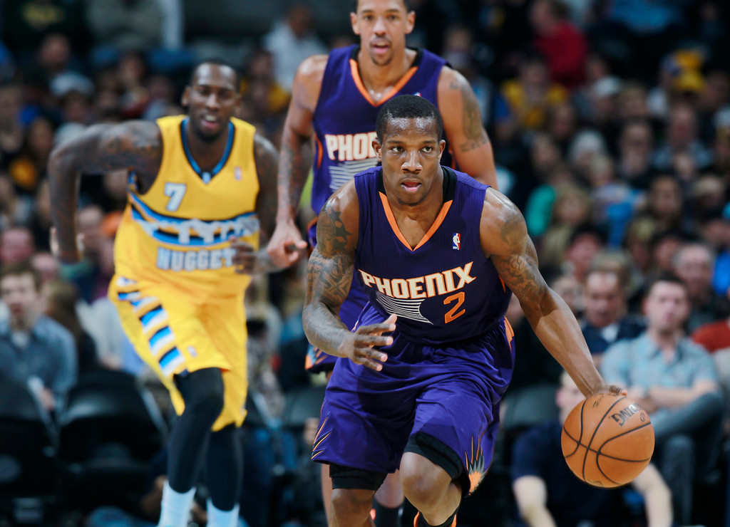 . Phoenix Suns guard Eric Bledsoe, front, picks up the loose ball Denver Nuggets forward J.J. Hickson, back left, and Suns center Channing Frye follow the play in the first quarter of an NBA basketball game in Denver on Friday, Dec. 20, 2013. (AP Photo/David Zalubowski)