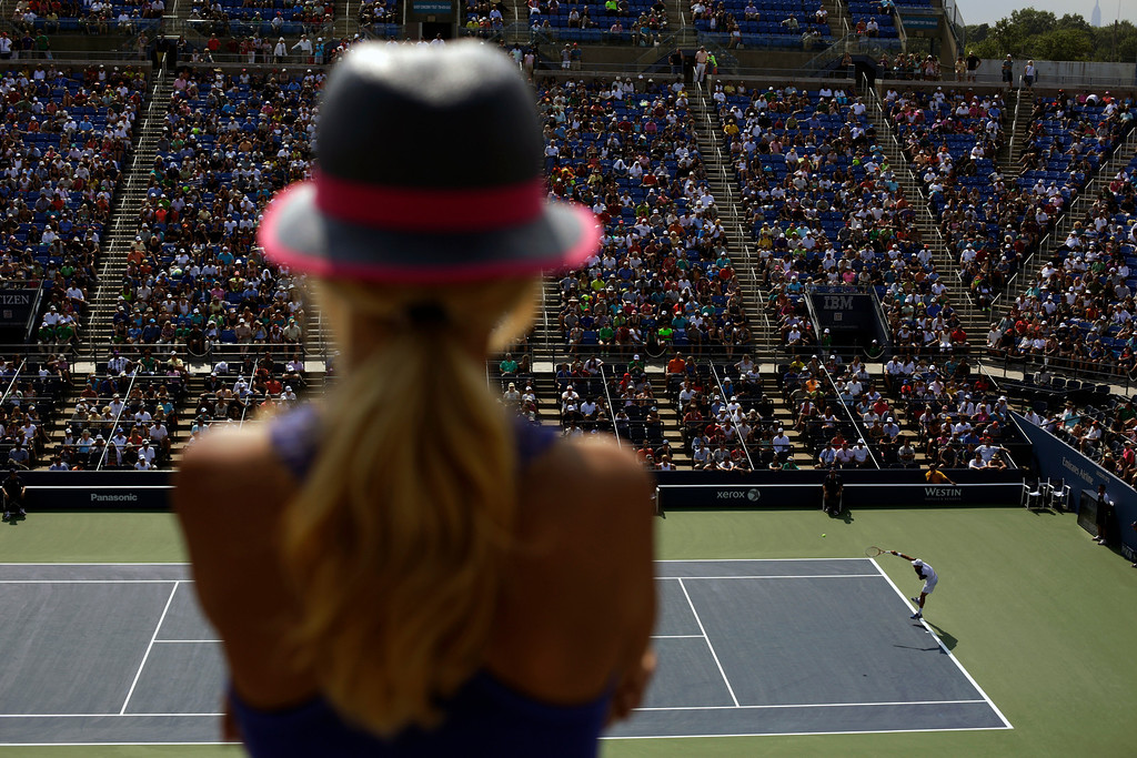 . A spectator watches play between David Ferre,r of Spain, and Roberto Bautista Agut, of Spai,n during the second round of the 2013 U.S. Open tennis tournament, Thursday, Aug. 29, 2013, in New York. (AP Photo/David Goldman)