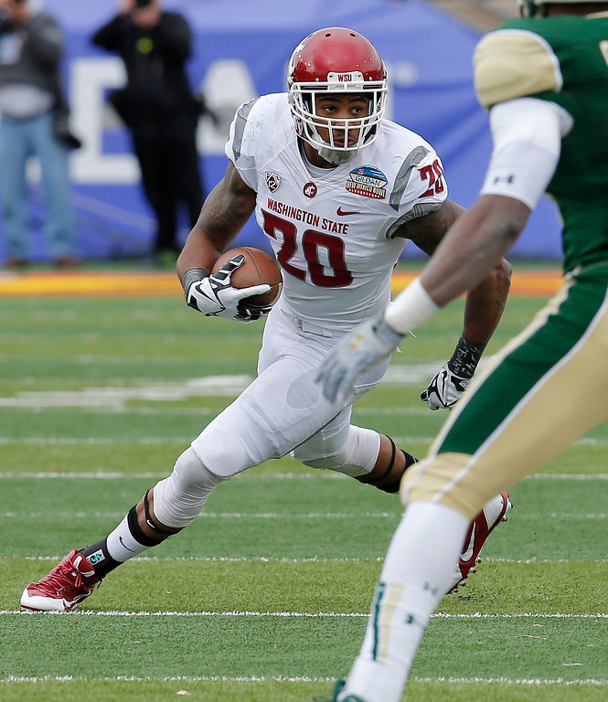 . In this Dec. 21, 2013, file photo, Washington State safety Deone Bucannon (20) runs back an interception during the first half of the NCAA New Mexico Bowl college football game against Colorado State in Albuquerque, N.M. Bucannon was selected in the first round, 27th overall, by the Arizona Cardinals in the NFL draft on Thursday, May 8, 2014. (AP Photo/Matt York, File)