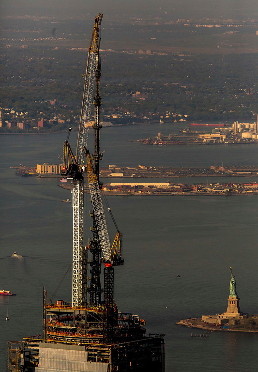 . The final piece of the One World Trade Center spire is attached to the building by ironworkers in New York May 10, 2013. The tower now rises to a symbolic 1,776 feet, making it the tallest building in the western hemisphere.    Gary He/INSIDER IMAGES/Handout via Reuters