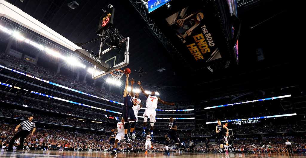. ARLINGTON, TX - APRIL 05:  Shabazz Napier #13 of the Connecticut Huskies goes to the basket as Michael Frazier II #20 and Patric Young #4 of the Florida Gators defend during the NCAA Men\'s Final Four Semifinal at AT&T Stadium on April 5, 2014 in Arlington, Texas.  (Photo by Ronald Martinez/Getty Images)