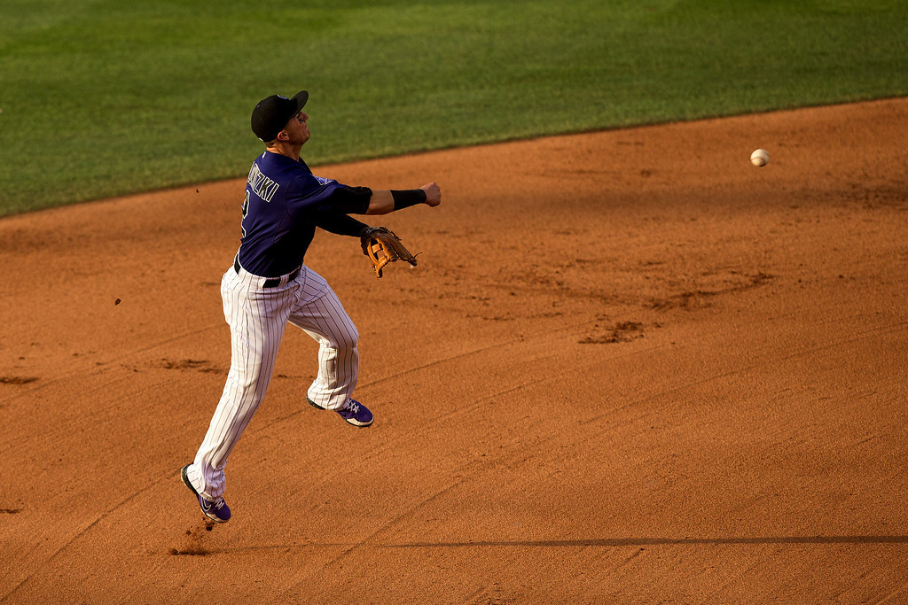. DENVER, CO - JULY 20:  Troy Tulowitzki #2 of the Colorado Rockies makes a throw on the run for the third out of the fourth inning against the Chicago Cubs at Coors Field on July 20, 2013 in Denver, Colorado.  (Photo by Justin Edmonds/Getty Images)