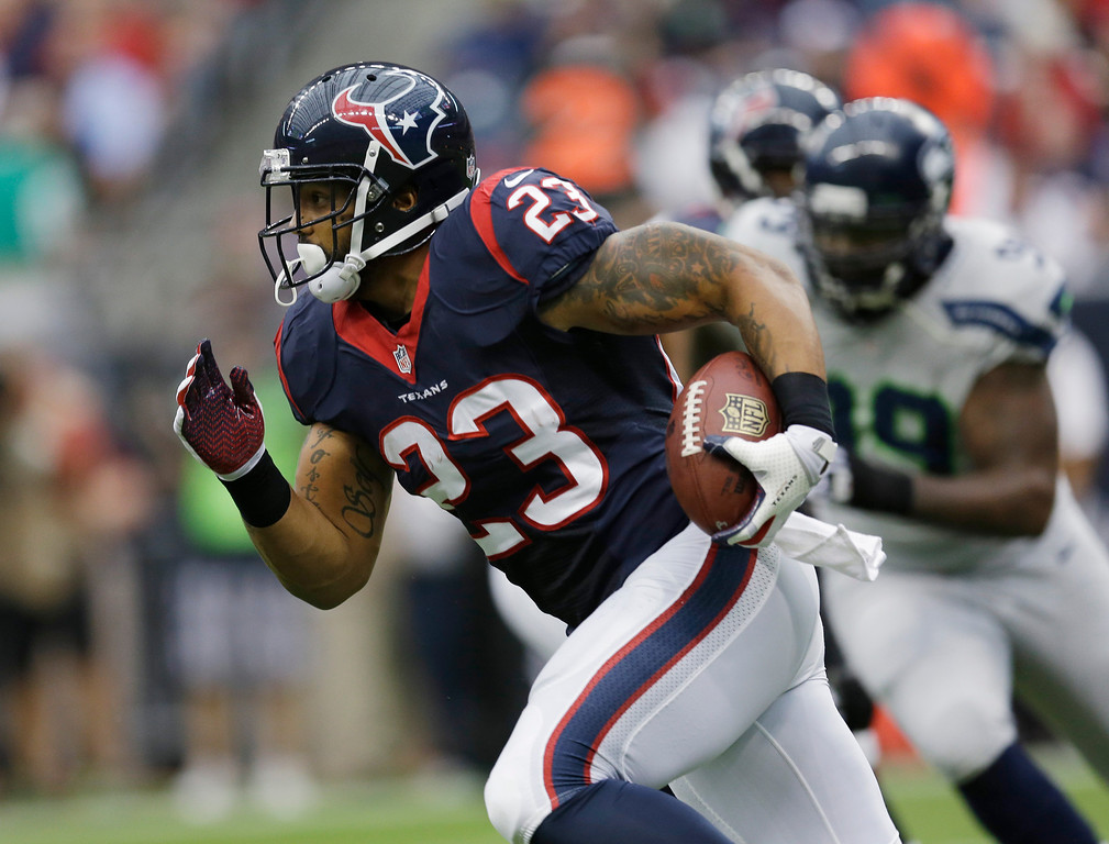 . Houston Texans\' Arian Foster (23) runs against the Seattle Seahawks during the first quarter an NFL football game Sunday, Sept. 29, 2013, in Houston. (AP Photo/David J. Phillip)