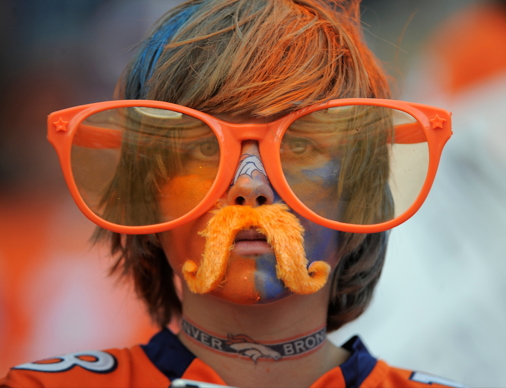 . Tobin Hoops, 12, from Denver, shows his team pride before the football game between the Denver Broncos and the Baltimore Ravens.   (Photo by John Leyba/The Denver Post)
