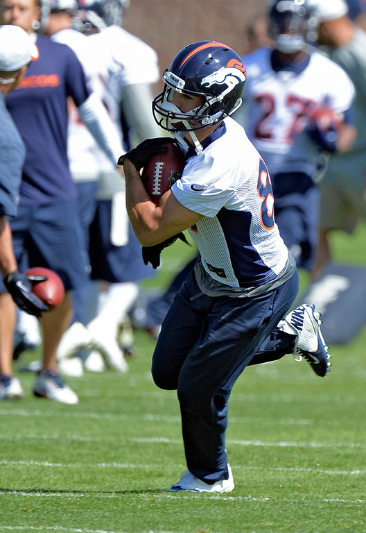 . Eric Decker of the Denver Broncos catches a pass during the teams OTAs May 20, 2013 at Dove Valley. All offseason training activities (OTAs) are voluntary until the mandatory minicamp June 11-13. (Photo By John Leyba/The Denver Post)