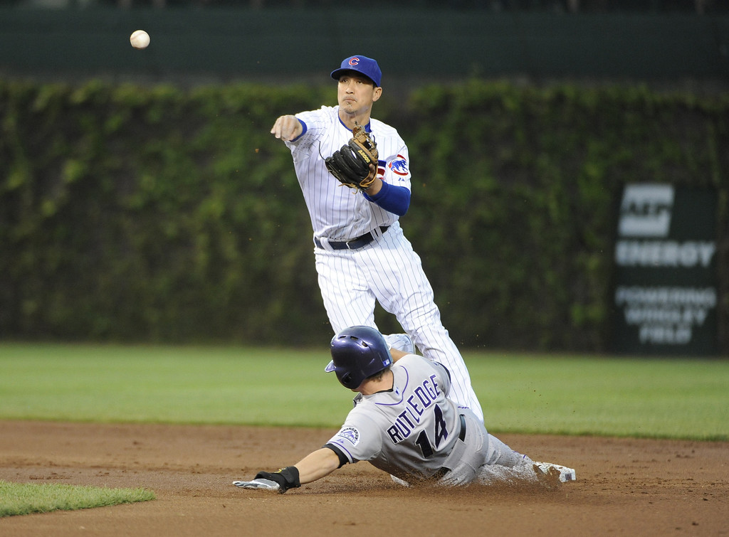 . Darwin Barney #15 of the Chicago Cubs forces out Josh Rutledge #14 of the Colorado Rockies during the second inning on May 15, 2013 at Wrigley Field in Chicago, Illinois.   (Photo by David Banks/Getty Images)