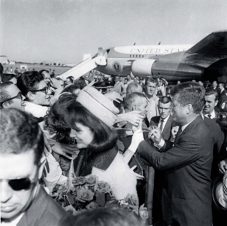 . President Kennedy and the first lady receive an enthusiastic welcome as they arrive at Dallas Love Field on Nov. 22, 1963.  Later that day, the president was assassinated as his motorcade moved through the city. Associated Press file