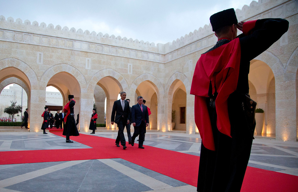 . President Barack Obama and Jordan\'s King Abdullah II walk from an official arriveal ceremony at Al-Hummar Palace, the residence of Jordanian King Abdullah II, Friday, March 22, 2013, in Amman, Jordan. (AP Photo/Carolyn Kaster)