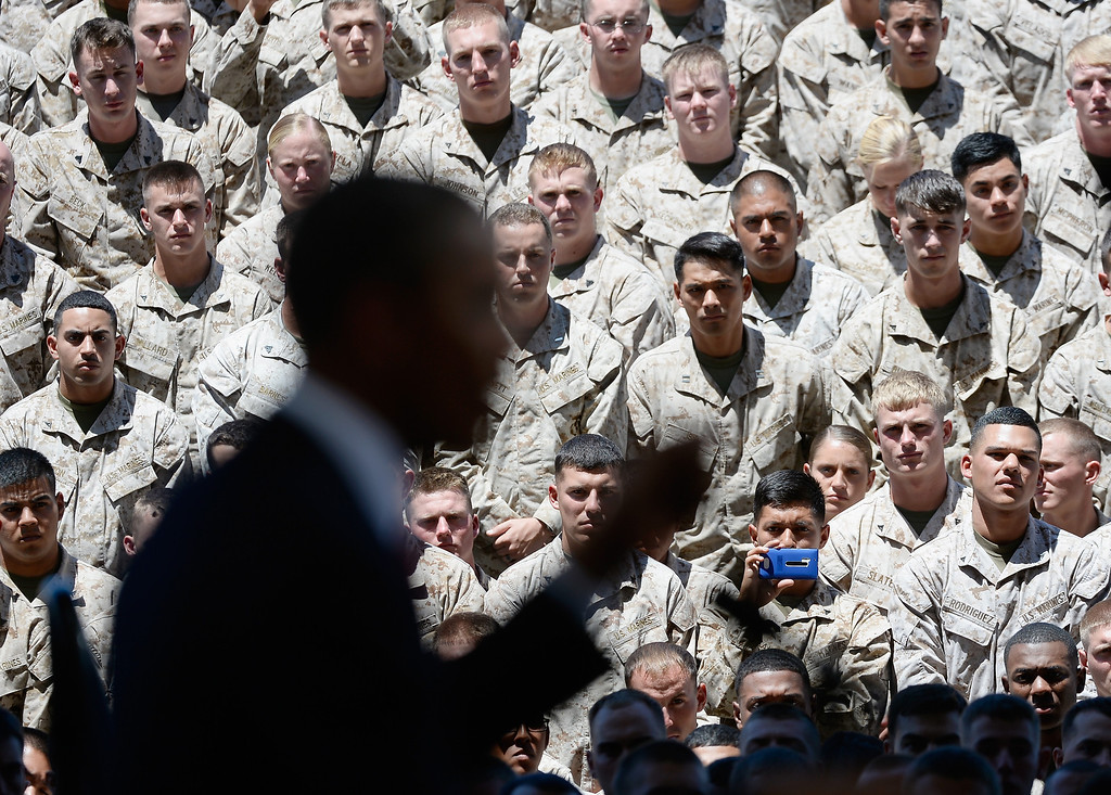 . CAMP PENDLETON, CA - AUGUST 07:  Members of U.S. marine Corps listens to U.S. President Barack Obama speech during his visit at Camp Pendleton Marine Corps base with troops and their families to thank them for their service on August 7, 2013 in Camp Pendleton, California. Obama announced today that he canceled a planned meeting with Russian President Vladimir Putin in Moscow amid tensions over National Security Agency leaker Edward Snowden and other issues.  (Photo by Kevork Djansezian/Getty Images)