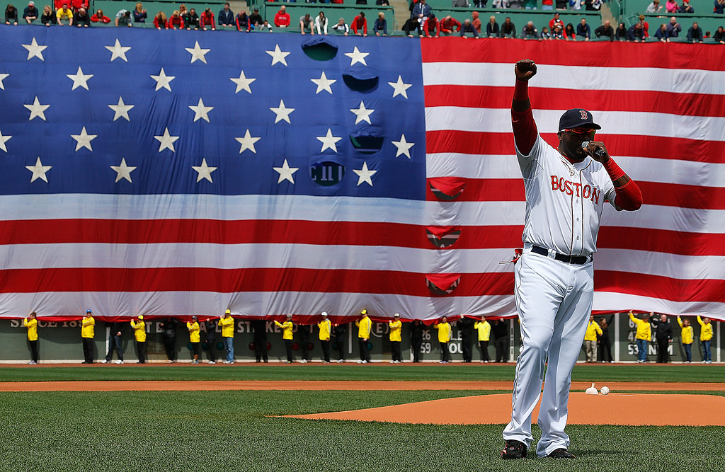 . BOSTON, MA - APRIL 20:  David Ortiz #34 of the Boston Red Sox speaks during a pre-game ceremony in honor of the bombings of Marathon Monday before a game at Fenway Park on April 20, 2013 in Boston, Massachusetts.  (Photo by Jim Rogash/Getty Images)