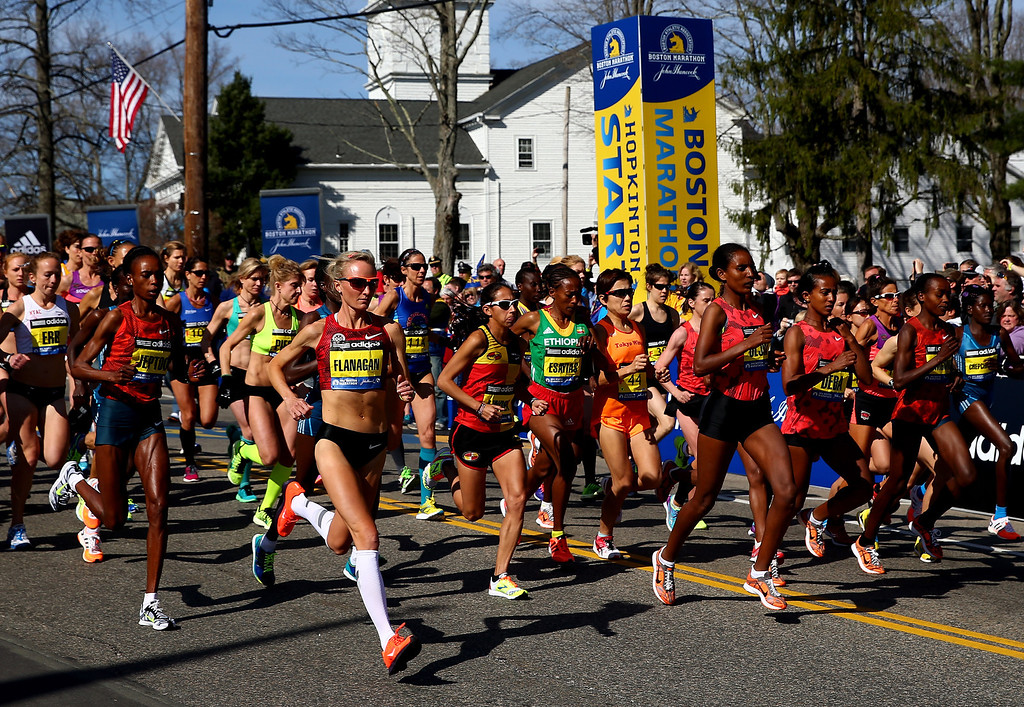 . The Elite Women\'s division starts the 118th Boston Marathon on April 21, 2014 in Hopkinton, Massachusetts.  (Photo by Alex Trautwig/Getty Images)