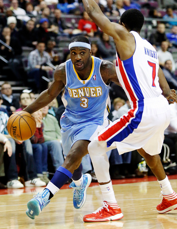 . Denver Nuggets guard Ty Lawson (3) drives against Detroit Pistons guard Brandon Knight (7) in the second half of an NBA basketball game, Tuesday, Dec. 11, 2012, in Auburn Hills, Mich. Lawson led all players with 26 points in their 101-94 win. (AP Photo/Duane Burleson)