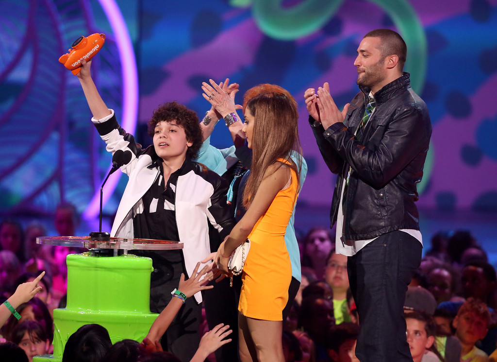 . From left, Cameron Ocasio, Ariana Grande, and Zoran Korach accept the award for favorite TV show for ìSam & Catî at the 27th annual Kids\' Choice Awards at the Galen Center on Saturday, March 29, 2014, in Los Angeles. (Photo by Matt Sayles/Invision/AP)