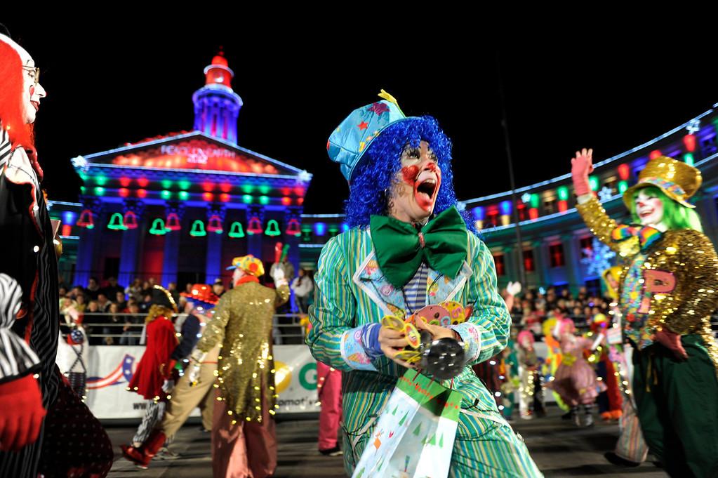 . A whole carload of clowns frolicked as the parade got under way Friday night. The annual Parade of Lights filed past the illuminated City and County building in downtown Denver Friday night, November 30. 2012. The parade with 11 floats, 7 bands, 5 giant balloons and more lights than anyone could count, had enough holiday spirit for everyone. Karl Gehring/ The Denver Post