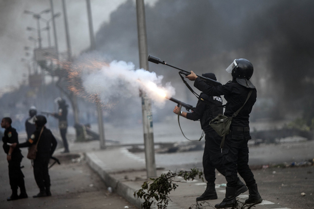 . Egyptian Riot policemen fire tear gas towards supporters during a demonstration of Muslim Brotherhood and ousted President Mohamed Morsi on November 29, 2013 in Cairo, Egypt.  AFP PHOTO/MAHMOUD KHALED/AFP/Getty Images