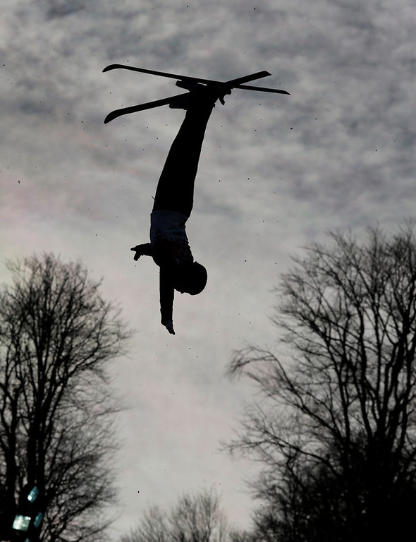 . A freestyle skier jumps during women\'s freestyle skiing aerials training at the Rosa Khutor Extreme Park, at the 2014 Winter Olympics, Friday, Feb. 14, 2014, in Krasnaya Polyana, Russia. (AP Photo/Andy Wong)
