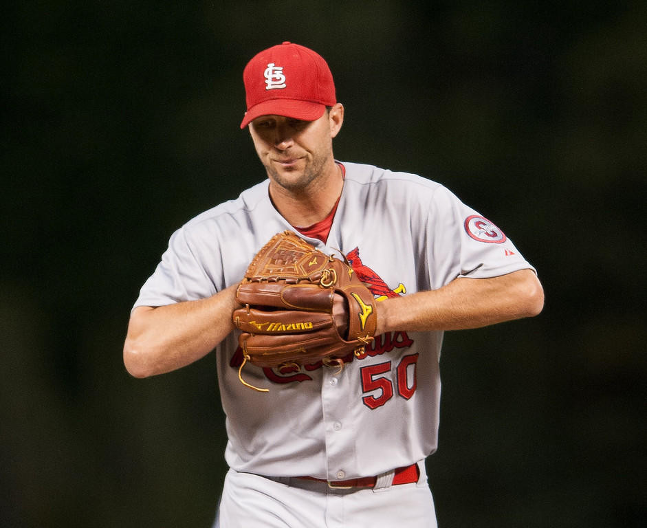 . Adam Wainwright #50 of the St. Louis Cardinals reacts after giving up two first inning runs against the Colorado Rockies in the first inning of a game at Coors Field on September 18, 2013 in Denver, Colorado. (Photo by Dustin Bradford/Getty Images)