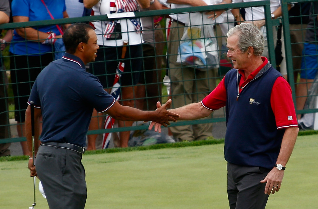 . DUBLIN, OH - OCTOBER 03:  President George W. Bush shakes hands with U.S. Team member Tiger Woods near the first tee before the start of the Day One Four-Ball Matches at the Muirfield Village Golf Club on October 3, 2013  in Dublin, Ohio.  (Photo by Gregory Shamus/Getty Images)