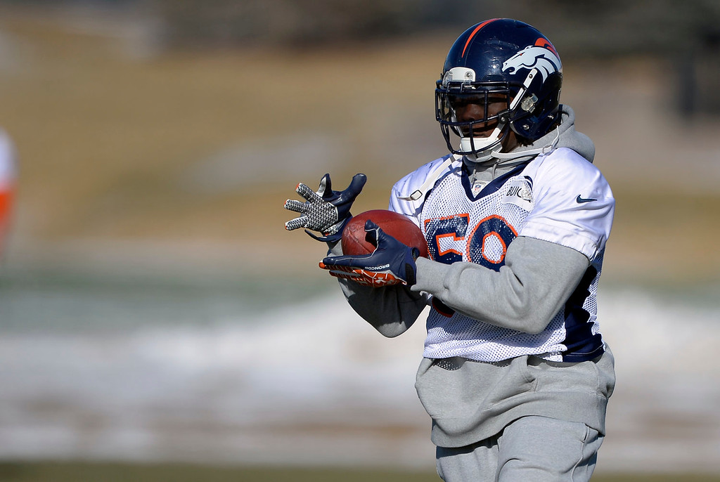 . Denver Broncos outside linebacker Danny Trevathan (59) catches a pass during drills at practice January 2, 2014 at Dove Valley (Photo by John Leyba/The Denver Post)