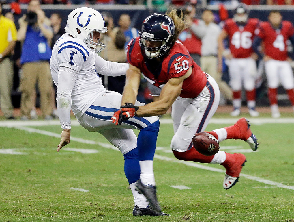 . Houston Texans\' Bryan Braman (50) blocks a punt by Indianapolis Colts\' Pat McAfee during the first quarter of an NFL football game Sunday, Nov. 3, 2013, in Houston. (AP Photo/David J. Phillip)