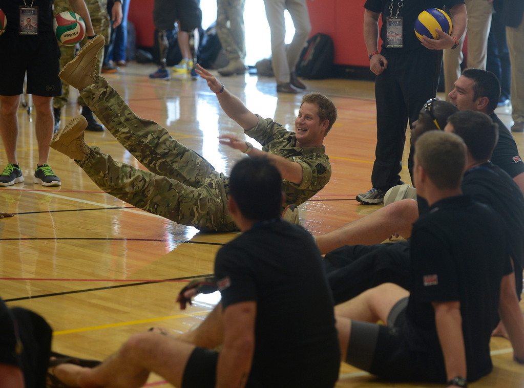 . COLORADO SPRINGS, CO - MAY 11: Britain\'s Prince Harry, falls back a little after hitting the volleyball with the British Armed Forces volleyball team members at the United States Olympic Training Center before the opening ceremonies at the 2013 Warrior Games Saturday morning, May 11th, 2013.(Photo By Andy Cross/The Denver Post)