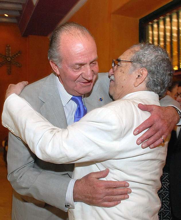 . In this  March 26, 2007 file photo released by Colombia\'s News Service SNE, Spain\'s King Juan Carlos, left, embraces Colombian Nobel laureate Gabriel Garcia Marquez at the International Congress of Spanish Language\'s opening ceremony in Cartagena, Colombia. Marquez died on Thursday, April 17, 2014 at his home in Mexico City. (AP Photo/Cesar Carrion, SNE)