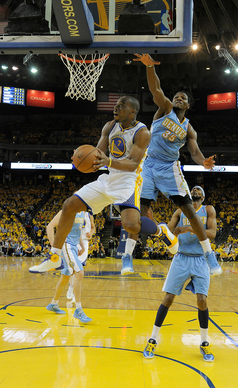 . OAKLAND, CA. - APRIL 26: Carl Landry (7) of the Golden State Warriors goes up and under th basket for a score as Kenneth Faried (35) of the Denver Nuggets defends on the play in game 3 of the first round of the NBA Playoffs April 26, 2013 at Oracle Arena.  (Photo By John Leyba/The Denver Post)