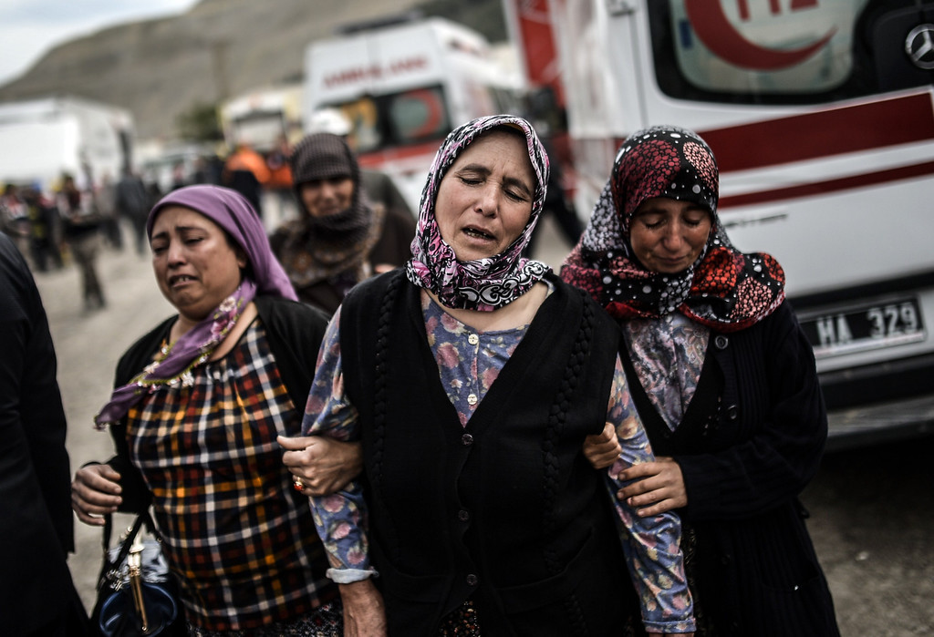 . Women cry for miners as 120 workers were believed to remain trapped in a mine after a deadly explosion that claimed the lives of at least 238 people on May 14, 2014 in a coal mine of the western Turkish province of Manisa.  AFP PHOTO/BULENT KILIC/AFP/Getty Images