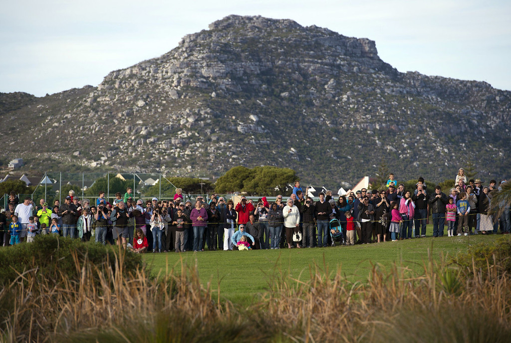 . Hundreds watch as Marine One helicopter, with US President Barack Obama aboard, lands at a field prior to Obama\'s tour of the Desmond Tutu HIV Foundation Youth Centre in Cape Town, South Africa, on June 30, 2013.  SAUL LOEB/AFP/Getty Images